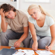 Despaired stressed couple calculating their expenses — Stock Photo #11184831
