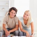 Happy couple calculating — Stock Photo #11184835