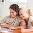 Cute couple with a laptop — Stock Photo