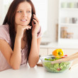 Woman telephoning in kitchen — Stock Photo #11184890