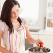 Stock Photo: Womcooking in kitchen