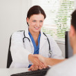 Female doctor greeting a patient — Stock Photo