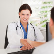 Female doctor hand shaking with patient — Stock Photo