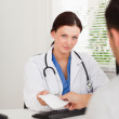 Stockfoto: Kind female doctor giving patient prescription