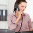 Businesswoman with telephone looking to screen — Stock Photo