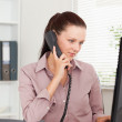 Focused businesswoman with telephone — Stock Photo