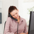 Busy businesswoman in office — Stock Photo