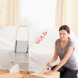 Stock Photo: Wompreparing cardboards for transport