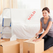 Female preparing cardboard box for transport — Stock Photo #11185188