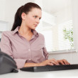 Businesswoman typing on keyboard - Stock Photo