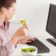 Royalty-Free Stock Photo: Businesswoman eating salad