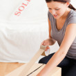 Woman preparing a cardboard for transport — Stock Photo