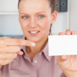 Business woman pointing at a card — Stock Photo