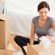 Young woman clearing out - Stock Photo