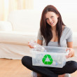 Cute woman with a recycling box - Stock Photo