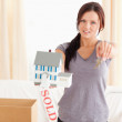 Young woman holding model house and keys — Stockfoto #11185341