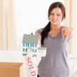 Young beautiful woman holding model house and keys — Stockfoto #11185342