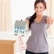 Stock Photo: Beautiful woman holding model house and keys