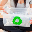 Woman with a recycling box - Stock Photo