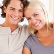 Portrait of a happy couple sitting on a sofa — Stock Photo