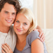 Lovely couple sitting on a couch — Stock Photo #11185600
