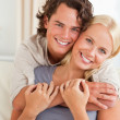 Stock Photo: Portrait of young couple embracing each other