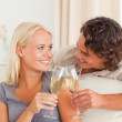 Portrait of a couple making a toast — Stock Photo