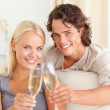 Lovely couple making a toast — Stock Photo #11185758