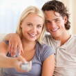 Close up of a cute couple watching TV — Stock Photo #11185959