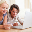 Close up of couple shopping online — Stock Photo