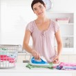 Cute Woman ironing clothes — Stock Photo