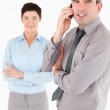 Portrait of a man making a phone call while his colleague is pos — Stock Photo #11187625