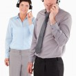 Portrait of office workers using headsets — Stock Photo