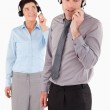 Portrait of office workers speaking through headsets — Stock Photo