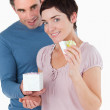 Portrait of a man surprising his fiance with a present — Stock Photo