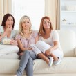 Happy Women watching a movie eating popcorn — Stock Photo #11188417