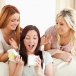 Joyful Girls giving their friend a present — Stock Photo