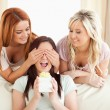 Smiling Girls giving their friend a present — Stock Photo #11188482