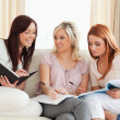Stock Photo: Joyful women studying together
