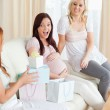 Laughing Friends having a baby-party — Stock Photo