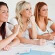 Fascinated students sitting at a table — Stock Photo