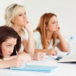 Bored-to-death students sitting at a table — Stock Photo