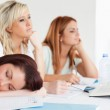 Bored university students one sleeping sitting at a table — Stock Photo #11188884