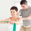 Patient doing some exercises under supervision — Stock Photo