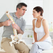 Woman listening to her chiropractor — Stock Photo #11189109