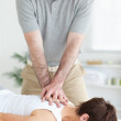 Handsome Man massaging a cute woman's neck — Stock Photo