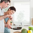 Cute Woman looking into a pan her husband is holding — Stock Photo