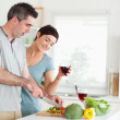 Handsome Man cutting vegetables while is woman is watching — Stock Photo