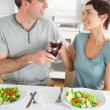 Close up of a Happy couple toasting with redwine — Stock Photo