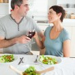 Close up of a cute couple toasting with redwine — Stock Photo